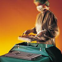 The Sterile Supply Cyle - Packaging: Taking out a tray from container
